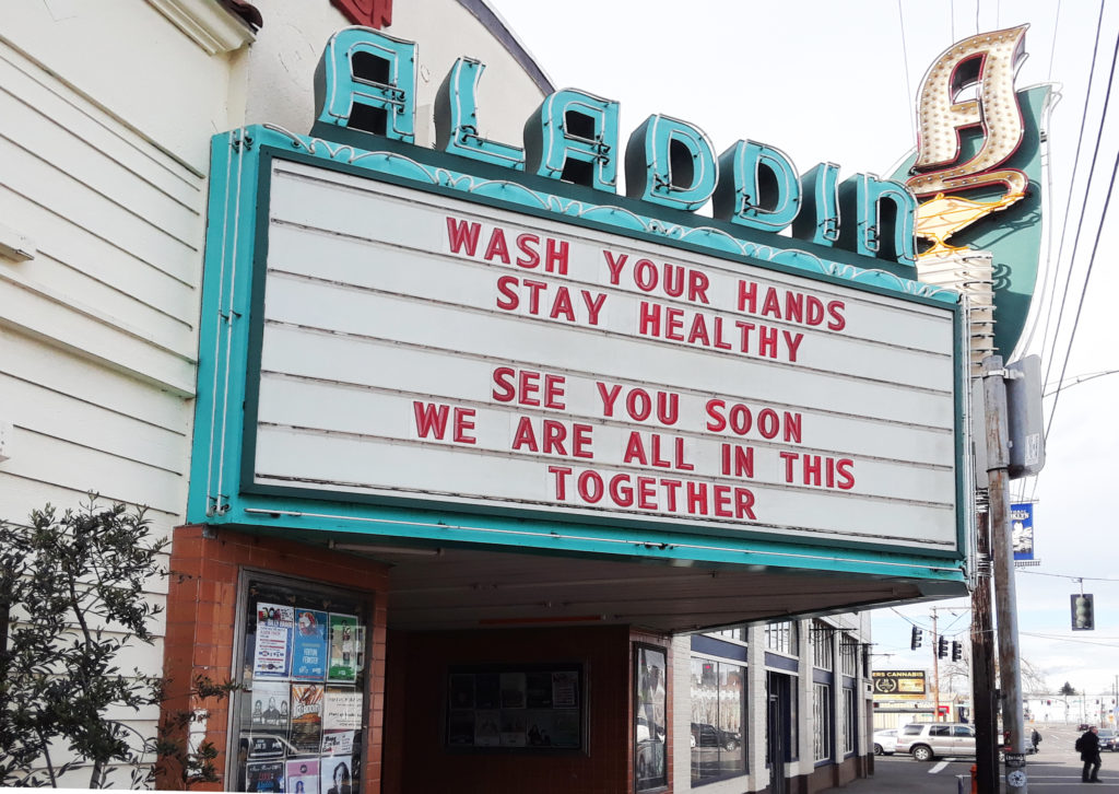 Marquee of the Aladdin Theater with the message: Wash your hands, stay healthy. See you soon. We are all in this together.